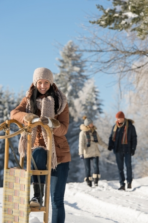 Sunny winter day people enjoy walking in snow countryside photo