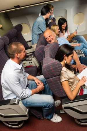 Leisure travel people enjoy flight airplane cabin talking passengers photo