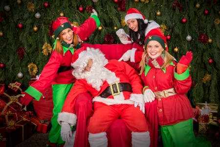 santa clause: Tired Santa Clause with elf helper sleep chair Christmas decoration