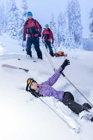 Ski patrol rescue injured woman after accident lying in snow photo