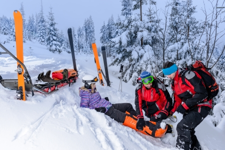 Ski patrol team rescue woman skier with broken leg