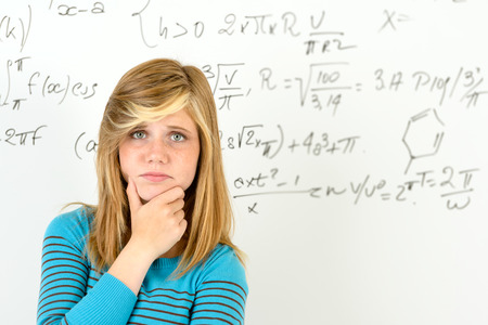 Desperate student girl standing in front of mathematics board photo