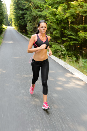 Runner - woman running outdoors training for marathon run motion blur Stock Photo - 25955543