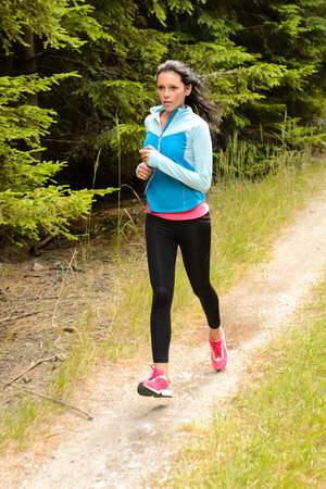 Woman jogging outdoor running on countryside path Stock Photo - 25955544