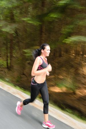 Runner - woman running outdoors training for marathon run motion blur Stock Photo - 25955546