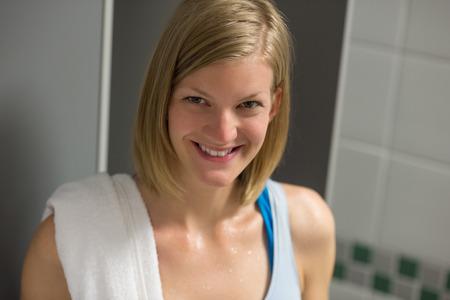 locker room: Sweaty fit woman in locker room at healthclub