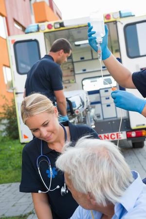 paramedical: Paramedical team helping injured elderly patient on street Stock Photo