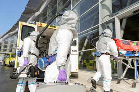 hazardous material team: HAZMAT team with stretcher and rescue equipment entering contaminated building