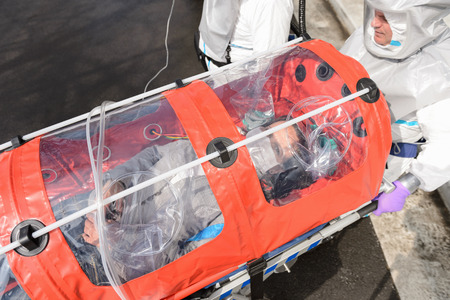 quarantine: Biohazard medical team with sick patient in stretcher virus contamination