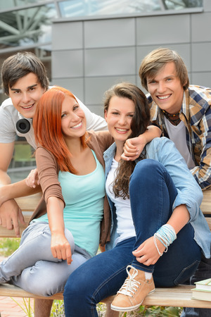 school friends: Cheerful group of high school friends hanging out outside campus Stock Photo