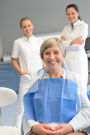 Senior woman patient with professional dentist team at dental surgery Stock Photo - 29952329