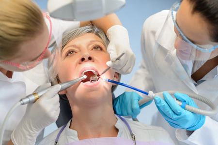 dental surgeon: Senior woman patient dental check open mouth professional dentist team