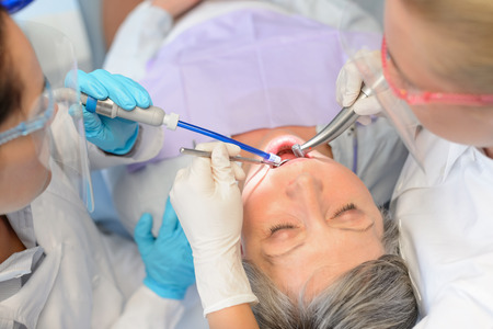 Dental checkup senior patient woman professional dentist team top view photo