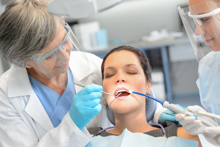 Dental check woman patient professional dentist team open mouth Stock Photo