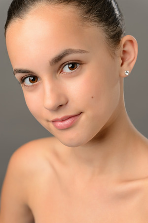bare shoulders: Teenage girl bare shoulders skin care beauty close-up gray shoulders Stock Photo