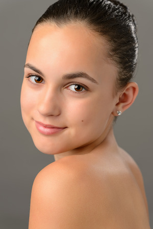 bare shoulders: Teenage girl bare shoulders skin beauty face portrait on gray