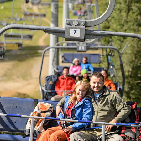 lipno: Couple hugging on romantic chairlift trip sunny day
