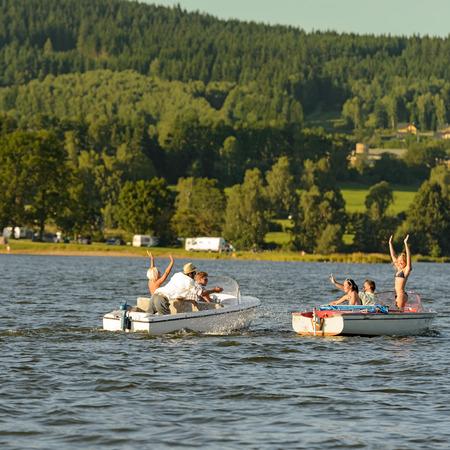 lipno: Young people having fun on motorboats on lake summertime