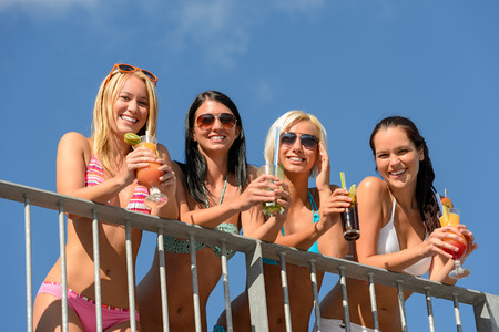 lipno: Beautiful women in bikinis and sunglasses smiling with drinks