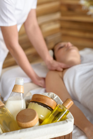 Beauty spa products in massage room woman enjoy treatment Stock Photo - 30414140