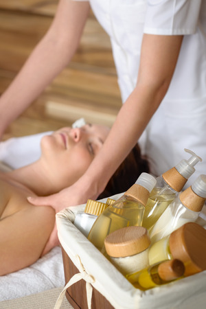 Beauty spa products in massage room woman enjoy treatment Stock Photo - 30414144