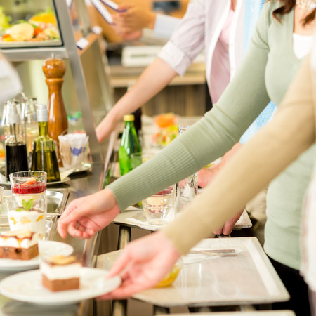 cafeteria tray: Desserts at cafeteria people with serving tray self service canteen