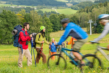 People hiking and riding bikes on summer vacation nature landscape photo