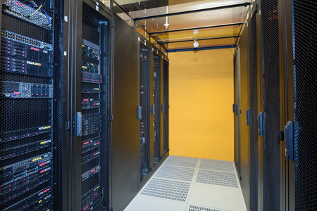 Climate controlled datacenter showing racks of internet servers Stock Photo