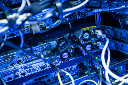 Backside of web servers in datacenter showing power connection cables Stock Photo