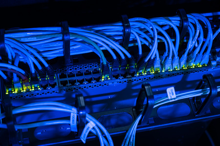 Network cables in switch in datacenter Stock Photo