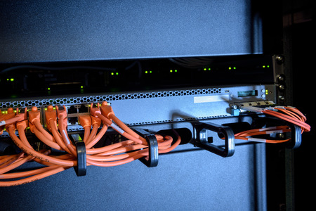 cables of internet switch in server room Stock Photo