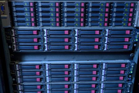 webserver: Rack of webserver harddisks in datacenter showing internet traffic Stock Photo