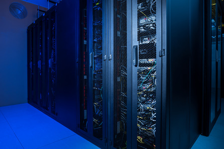 Datacenter internet servers in climate controlled room Stock Photo