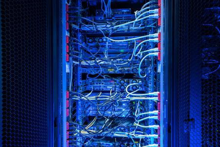 Backside of internet server rack showing power sockets connection