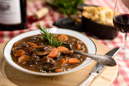 french beef bourguignon meat stew with carrots