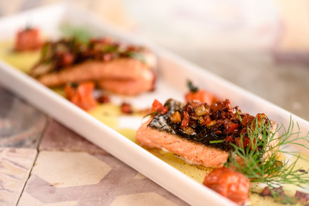 gastronomy: Grilled salmon fillet with provencal tomato and dill