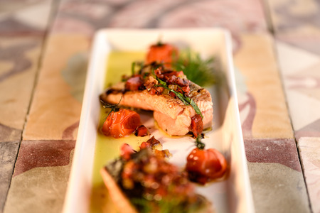 Homemade grilled salmon fillet with fresh tomato