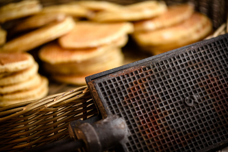 Original waffle iron with stacks of belgium breakfast waffles