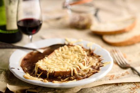 French onion soup with emmental grated cheese and bread croutons