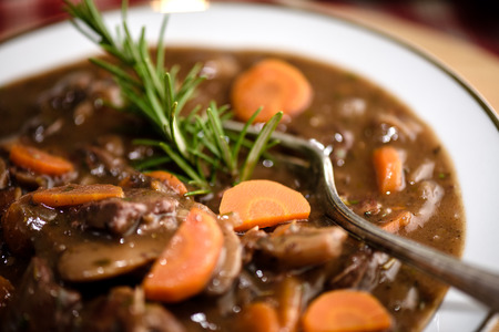 beef bourguignon meat stew with carrots and thyme