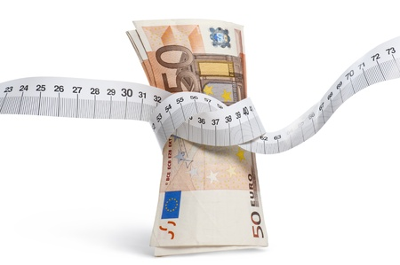 euro banknotes with measure tape on white background, orizzontal image Archivio Fotografico