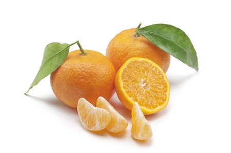 tangerines with slice and segments, on white background