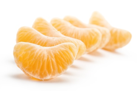 segments of tangerine, on white background photo