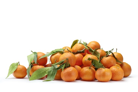 bunch of fresh tangerines with leaves, on white background