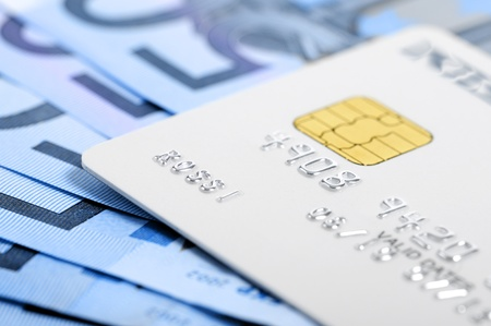credit card on banknotes Stock Photo