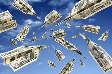 dollar banknotes flying on blue sky Stock Photo