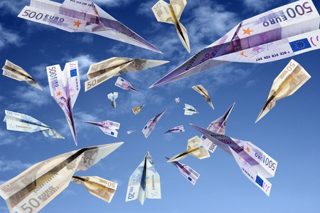 investment metaphor money: euro banknotes flying on blue sky