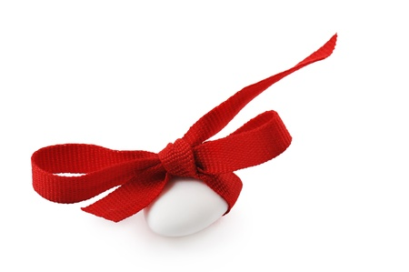 confetto: confectionery with red ribbon, isolated on white Stock Photo