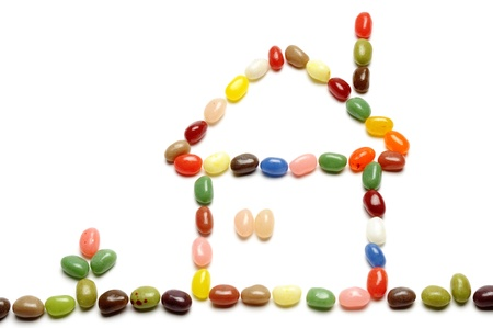fruit jelly beans, home-shaped on white background