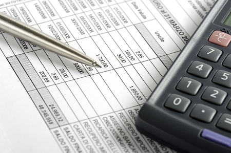 control of the bank statement, with pen and calculator